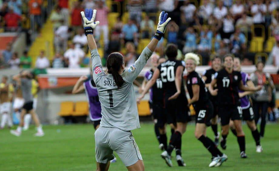 United States goalkeeper Hope Solo celebrates winning the quarterfinal match between Brazil and the United States at the WomenÕs Soccer World Cup in Dresden, Germany, Sunday, July 10, 2011. (AP Photo/Marcio Jose Sanchez) / AP2011