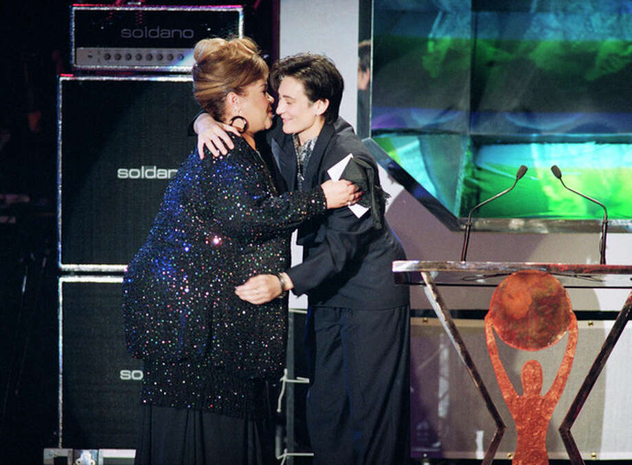 FILE - In this Jan. 13, 1993, photo, singer Etta James, left, gets a hug from fellow singer K d Lang as she is inducted to the Rock and Roll hall fame, in Los Angeles. The singer's manager says Etta James has died in Southern California. Lupe De Leon tells The Associated Press the singer died early Friday, Jan. 20, 2012 at Riverside Community Hospital. De Leon says the cause of death is complications of leukemia. (AP Photo/Kevork Djansezian) / AP1993