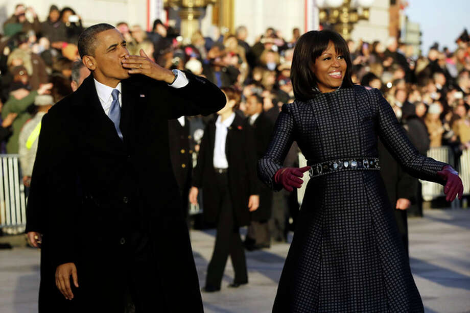 AP photo / Charles DharapakPresident Barack Obama blows a kiss as he and first lady Michelle Obama walk on Pennsylvania Avenue near the White House in the Inauguration Parade during the 57th Presidential Inauguration in Washington Monday. / AP2013