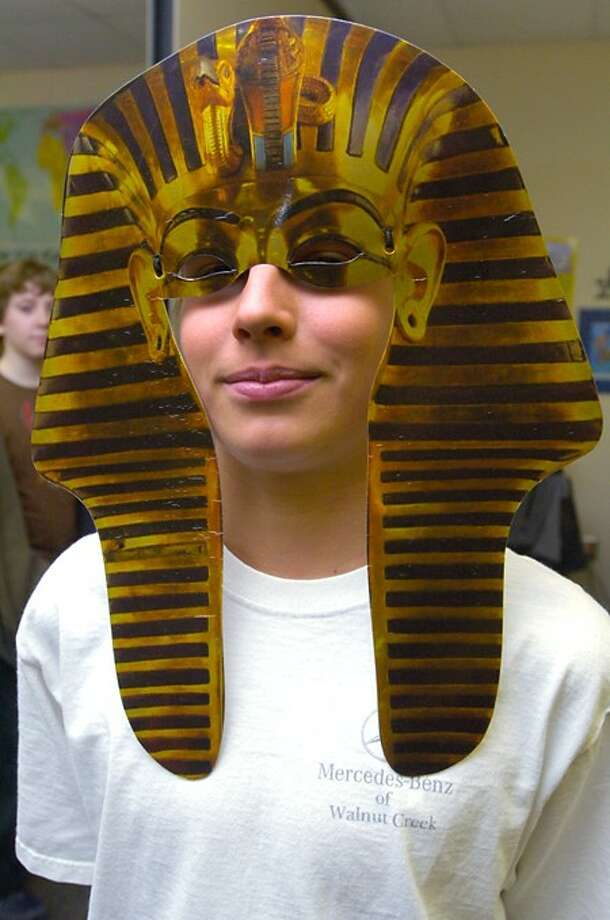 """MIddbrook Middle School 6th grader Harris McCool wears a phrow mask as part of his class''s celebration, """"The Mysteries of Egypt"""" where student projects were on view for teachers and parent Friday at the school. Hour photo / Erik Trautmann"""