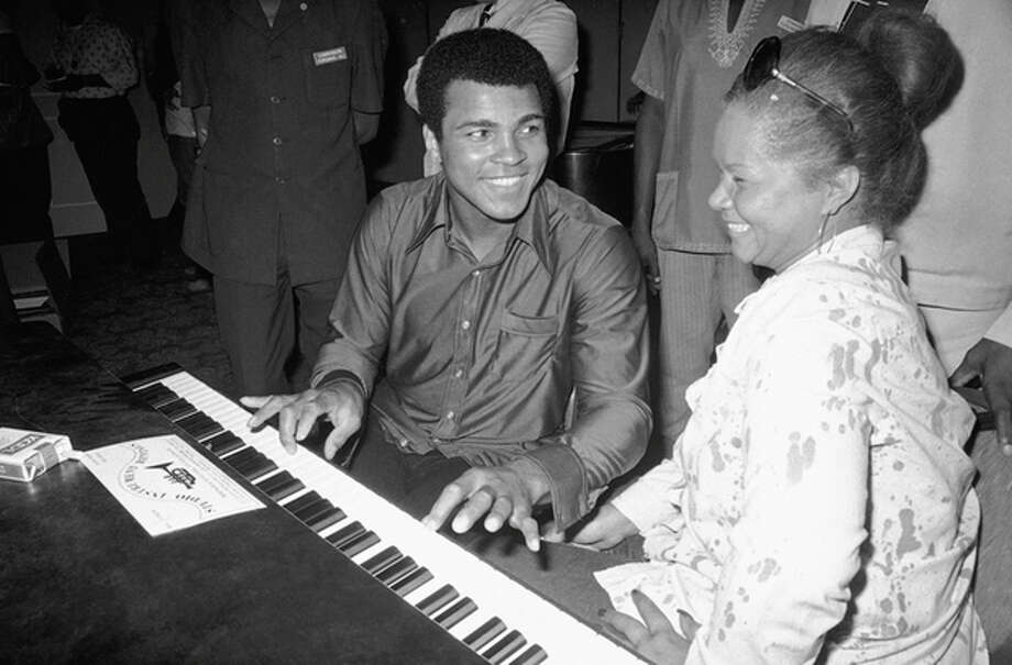 FILE - In this Sept. 22, 1974, photo, Muhammad Ali plays a few notes on the piano as singer Etta James looks on. The singer's manager says Etta James has died in Southern California. Lupe De Leon tells The Associated Press the singer died early Friday, Jan. 20, 2012 at Riverside Community Hospital. De Leon says the cause of death is complications of leukemia. (AP Photo/Horst Faas) / AP1974