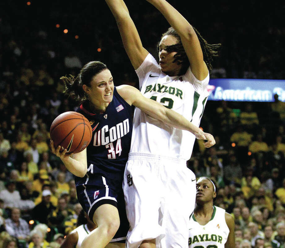 AP photo UConn guard Kelly Faris looks to pass around Baylor center Brittney Griner during the Dec. 18 clash. An Indiana native, Faris is excited to be playing before her home-state fans today against Notre Dame. / AP