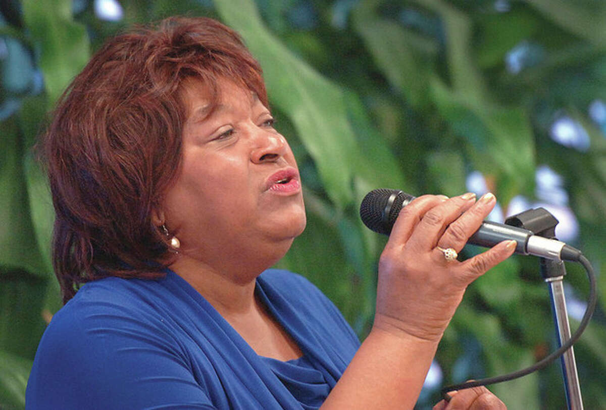 Hour photo/Alex von Kleydorff The Rev Nellie Mann sings during the Community Breakfast in Obervance of the Rev. Dr. Martin Luther King Jr. Day at West Rocks Middle School