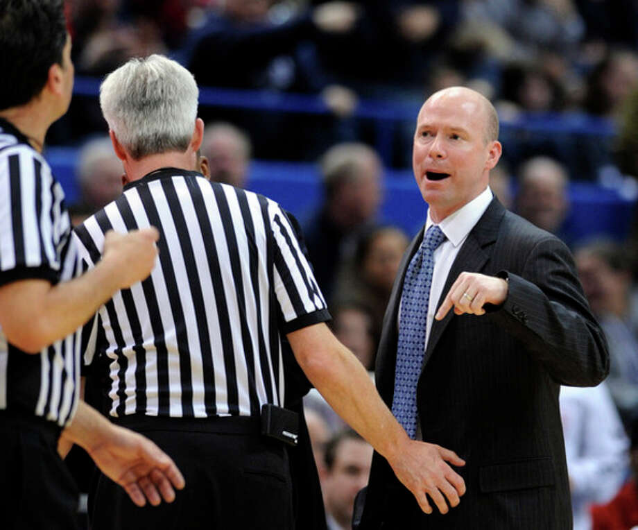 Seton Hall coach Kevin Willard speaks with referees during the second half of his team's 69-46 loss to Connecticut in an NCAA college basketball game in Hartford, Conn., on Saturday, Feb. 4, 2012. Willard received two technical fouls and was ejected from the game. (AP Photo/Fred Beckham) / FR153656 AP