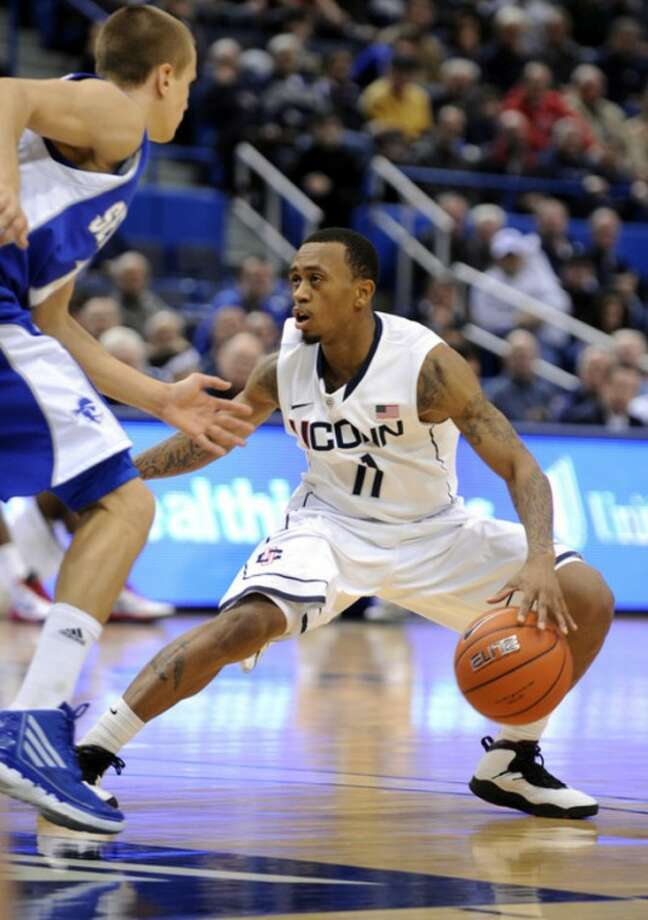 Connecticut's Ryan Boatright dribbles past Seton Hall's Haralds Karlis during the second half of his team's 69-46 victory in an NCAA college basketball game in Hartford, Conn., on Saturday, Feb. 4, 2012. (AP Photo/Fred Beckham)