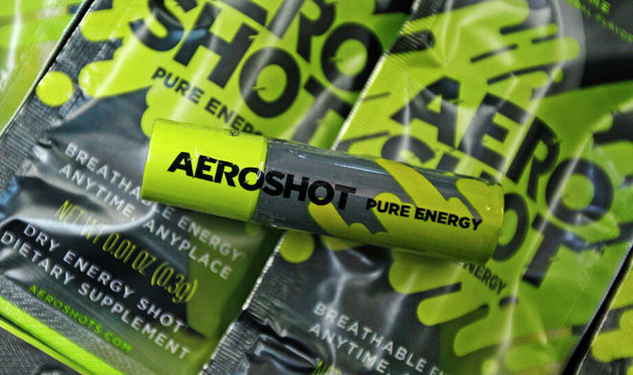 """An """"Aero Shot"""" caffeine device is displayed in Boston, Tuesday Feb. 7, 2012. The lipstick-sized product went on the market late last month in Massachusetts and New York, and is also available in France. A single unit costs $2.99 at convenience, mom-and-pop, liquor and online stores. (AP Photo/Charles Krupa) / AP"""