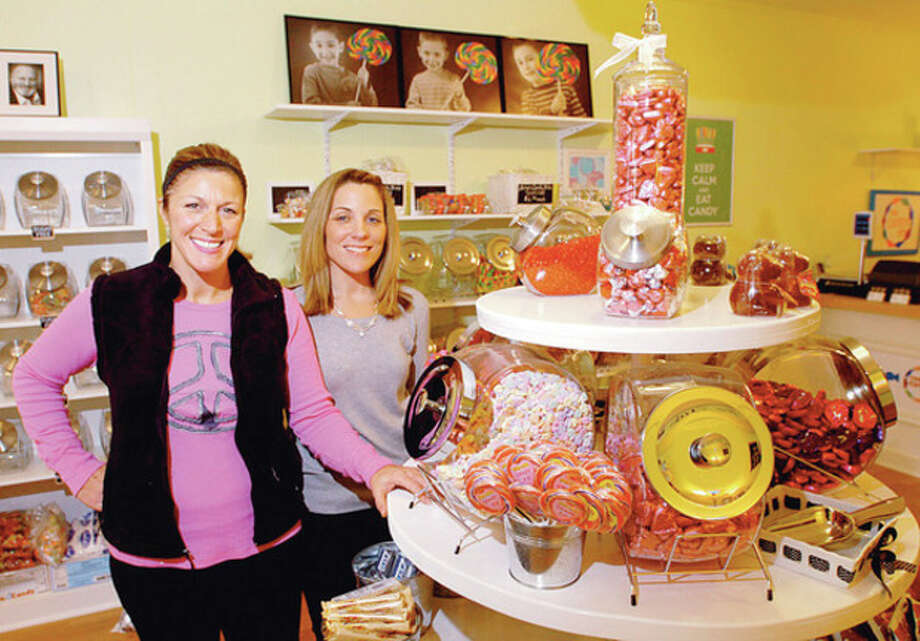 Hour photo / Erik Trautmann Lisa Nuzzo and Michele Mancini, owners of new candy store, The Candy Bin, stand in their store at One Danbury Road in Wilton. / (C)2011, The Hour Newspapers, all rights reserved
