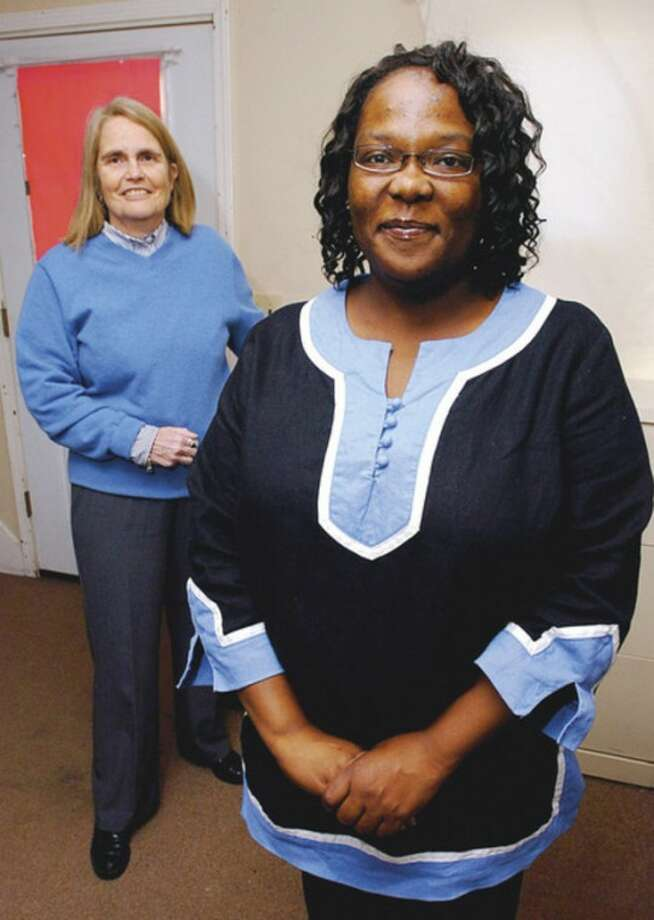 Hour photo / Erik Trautmann Akisha Cassermere, founder of Breakthrough Options for Families, a Norwalk-based organization that serves single, low-income parents, and the organization's vice president (in rear), Pat Nivakoff.