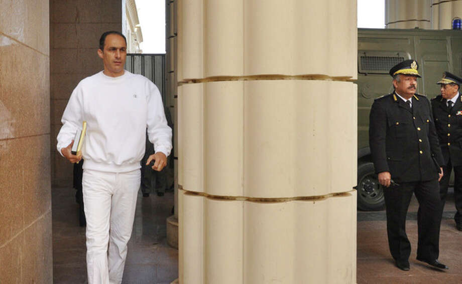 Gamal Mubarak, son of former Egyptian president Hosni Mubarak, left, arrives at a court house in Cairo, Egypt, Tuesday, Jan. 17, 2012. Hosni Mubarak and his two sons, wealthy businessman Alaa and his one-time heir apparent Gamal face corruption charges in the same case. All three were in court Tuesday. (AP Photo/Mohammed al-Law) / AP