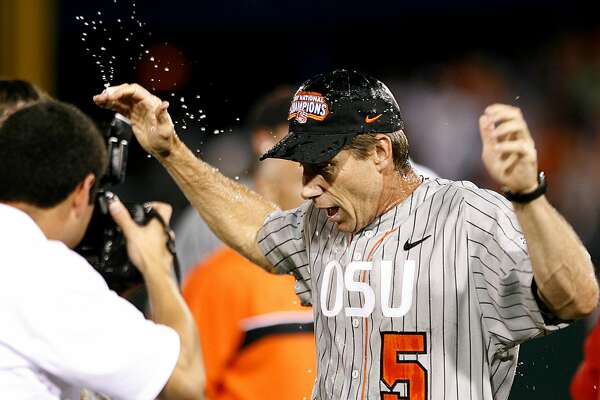 OMAHA, NE - JUNE 24:  Head coach Pat Casey #5 of the Oregon State Beavers reacts after getting doused with water following his team's 9-3 win over the North Carolina Tar Heels to claim a second straight NCAA Championship in Game 2 of the NCAA College World Series Championship at Rosenblatt Stadium on June 24, 2007 in Omaha, Nebraska. (Photo by Kevin C. Cox/Getty Images)