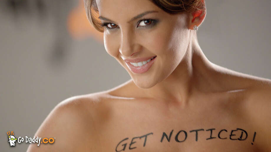 "This advertisement provided by GoDaddy.com, shows a scene from the ad ""Body Paint,"" featuring Colombian model Natalia Velez. The ad will air during Super Bowl XLVI, Sunday, Feb. 5, 2012. (AP Photo/GoDaddy.com) / GoDaddy.com"