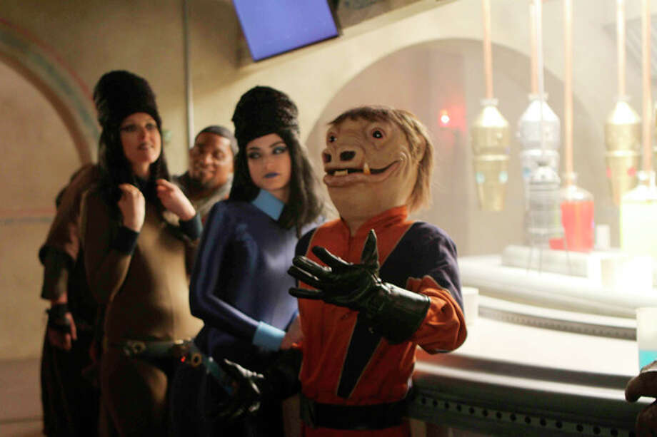 "This advertisement provided by Volkswagen of America Inc., that shows a creature and friends at the bar of the Cantina, is scheduled to air during Super Bowl XLVI, Sunday, Feb. 5, 2012. Volkswagen charmed millions of viewers last year with a ""Star Wars"" themed ad introducing its redesigned 2012 Passat sedan that showed a little boy in a Darth Vader costume trying to use ""The Force"" on different objects. (AP Photo/Volkswagen of America Inc.) / Copyright 2012 The Associated Press. All rights reserved. This material may not be published, broadcast, rewritten or redistributed."
