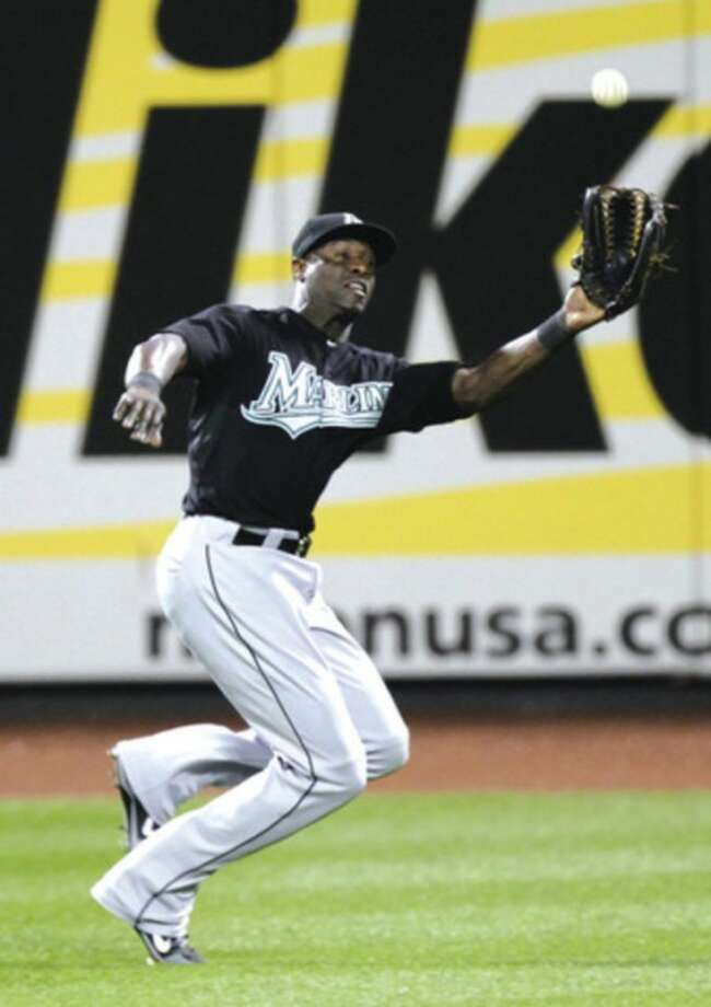 AP photo Mike Cameron of the Florida Marlins catches a fly ball hit by New York Mets' Jason Bay Tuesday.