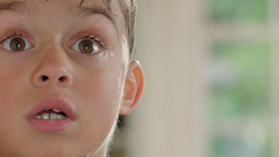 This advertisement provided by 2nd Story Software, shows an ad of a little boy in a pool realizing he needs to use the bathroom and then people keep beating him to the restroom. The ad will be aired during Super Bowl XLVI, Sunday, Feb. 5, 2012. (AP Photo/2nd Story Software) / 2nd Story Software