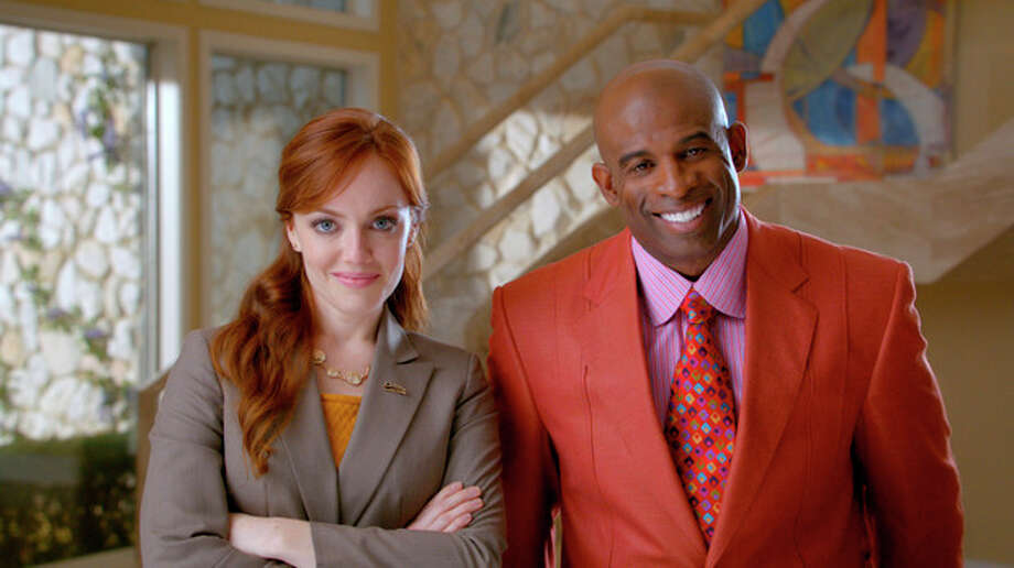 "This advertisement provided by Century 21, shows a scene from the ad ""Smarter, Bolder, Faster,"" with a Century 21 saleswoman and NFL analyst Deion Sanders. The ad will air during Super Bowl XLVI, Sunday, Feb. 5, 2012. (AP Photo/Century 21) / Century 21"