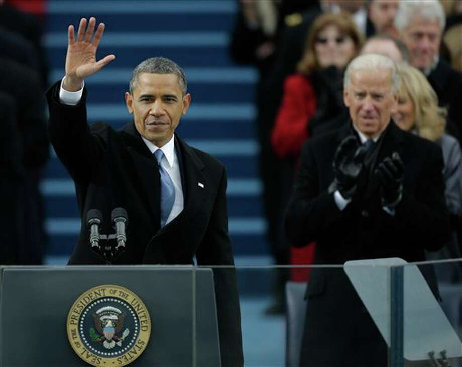 President Barack Obama waves after his speech while Vice President Joe Biden applauds at the ceremonial swearing-in at the U.S. Capitol during the 57th Presidential Inauguration in Washington, Monday, Jan. 21, 2013. (AP Photo/Pablo Martinez Monsivais) / AP2013