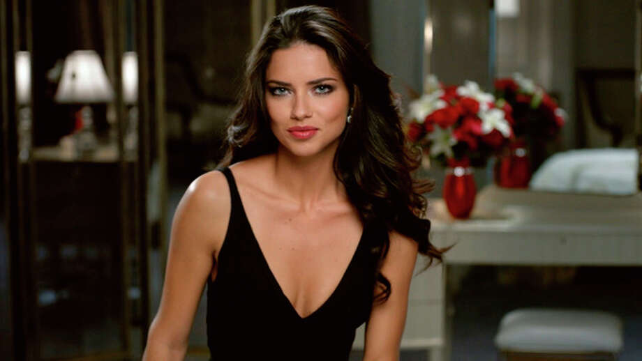 This advertisement provided by Teleflora, shows a scene from the ad with super-model Adriana Lima set to launch during Super Bowl XLVI, which will air Sunday, Feb. 5, 2012. Teleflora's 30-second spot will debut during the game's second quarter. About 20 of the roughly 36 Super Bowl advertisers put their TV commercials online in the days leading up to Sunday's broadcast. That's a big break with tradition and up from last year when only a handful of companies released their ads before the game. Millions have already viewed Lima's pre-released Teleflora ad. (AP Photo/Telaflora) / Teleflora