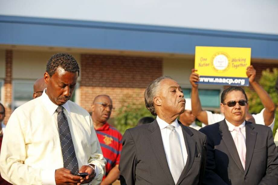 Al Sharpton prepares to speak at a local NAACP rally in support of Tonya McDowell held at Brookside School in Norwalk Tuesday evening. Hour Photo / Danielle Robinson