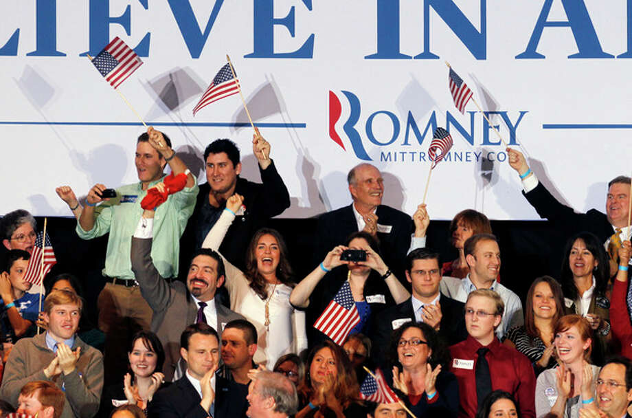 Supporters of Republican presidential candidate, former Massachusetts Gov. Mitt Romney, cheer the closing of the polls at his Florida primary primary night rally in Tampa, Fla., Tuesday, Jan. 31, 2012. (AP Photo/Gerald Herbert) / AP