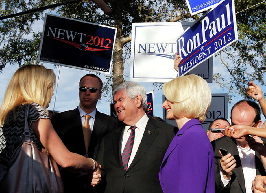 Republican presidential candidate, former House Speaker Newt Gingrich, accompanied by his wife Callista, campaigns outside a polling place at the First Baptist Church of Windermere in Orlando, Fla., Tuesday, Jan. 31, 2012. (AP Photo/Matt Rourke) / Copyright 2012 The Associated Press. All rights reserved. This material may not be published, broadcast, rewritten or redistributed.
