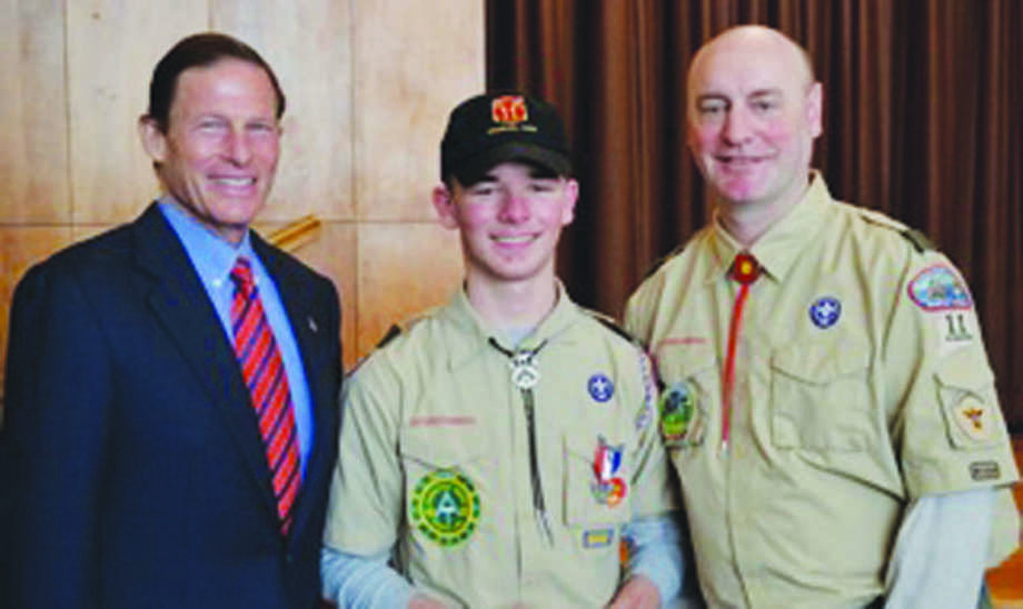 Eagle Scout Matthew Crohan, center, with U.S. Sen. Richard Blumenthal, left, and Troop 11 Scoutmaster Richard Baron, right.