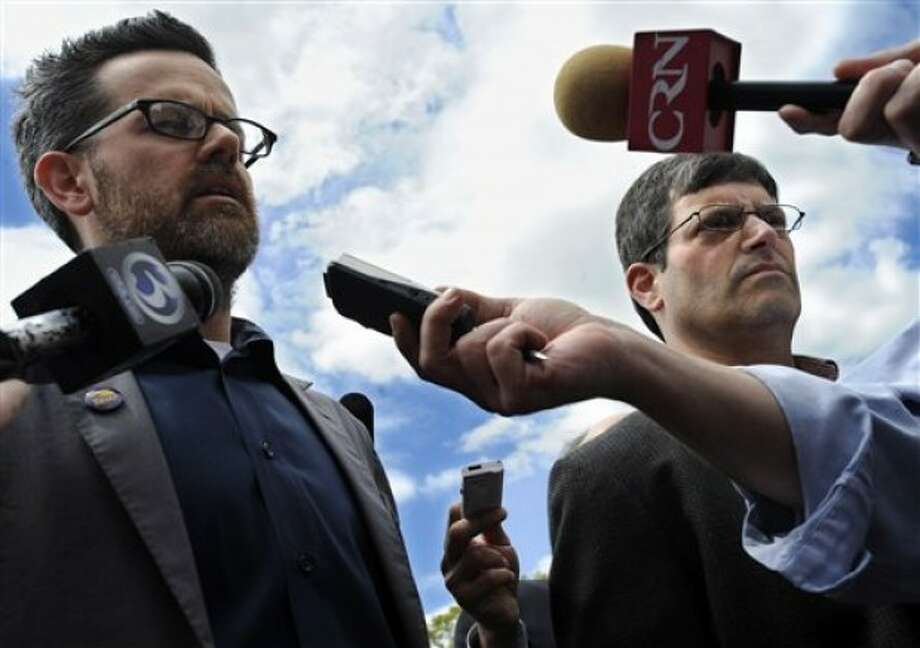 Matt O''Connor, left, and Larry Dorman, right, the spokesmen for The State Employees Bargaining Agent Coalition (SEBAC) right, speak to the media outside the State Capitol in Hartford, Conn., Tuesday, May 10, 2011. Gov. Dannel P. Malloy said his administration is beginning the process Tuesday of issuing 4,742 layoff notices to Connecticut state employees because a two-year, $2 billion labor savings deal has not yet been reached with unionized workers. SEBAC represents 15 Unions and about 45,000 state workers. (AP Photo/Jessica Hill)