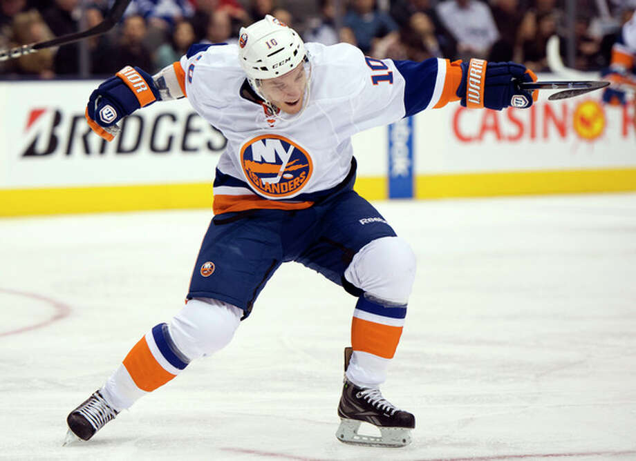 New York Islanders center Keith Aucoin celebrates his goal against the Toronto Maple Leafs during the third period of their NHL hockey game, Thursday, Jan. 24, 2013, in Toronto. The Islanders won 7-4. (AP Photo/The Canadian Press, Frank Gunn) / The Canadian Press