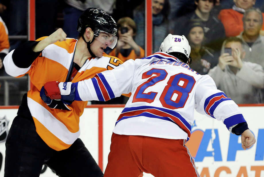 Philadelphia Flyers' Tye McGinn, left, and New York Rangers' Kris Newbury fight during the second period of an NHL hockey game, Thursday, Jan. 24, 2013, in Philadelphia. (AP Photo/Matt Slocum) / AP