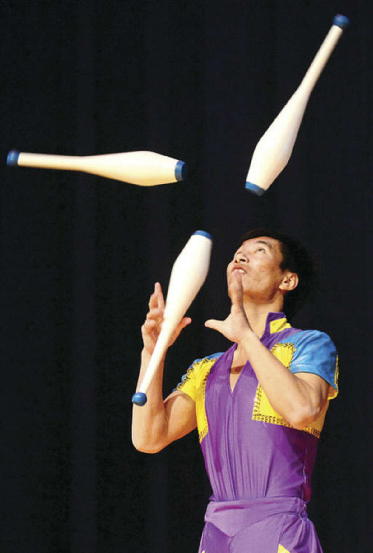 All Saints Catholic School hosted the Chinese Acrobat troupe from Bejing as part of the cultural enrichment program and to help kick off National Catholic Schools week Thursday morning. Hour photo / Erik Trautmann