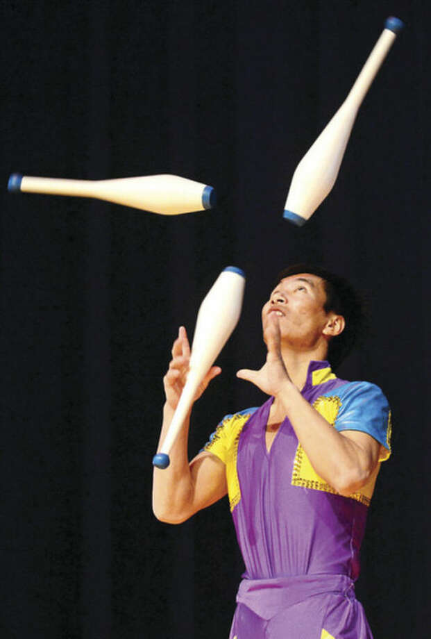 All Saints Catholic School hosted the Chinese Acrobat troupe from Bejing as part of the cultural enrichment program and to help kick off National Catholic Schools week Thursday morning.Hour photo / Erik Trautmann