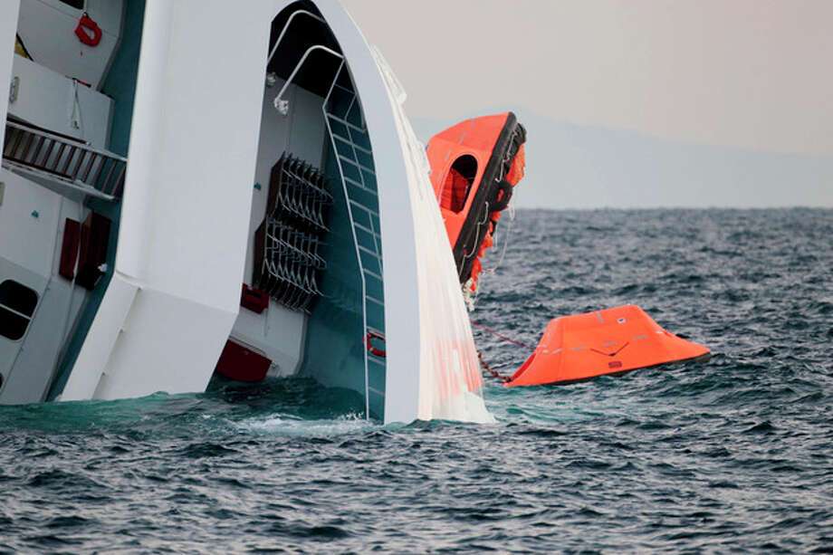 A rescue dinghy hangs from the side of the luxury cruise ship Costa Concordia leaning on its side after ran aground off the tiny Tuscan island of Giglio, Italy, Sunday, Jan. 15, 2012. The Costa Concordia cruise ship ran aground off the coast of Tuscany, sending water pouring in through a 160-foot (50-meter) gash in the hull and forcing the evacuation of some 4,200 people from the listing vessel early Saturday, the Italian coast guard said. (AP Photo/Gregorio Borgia) / AP