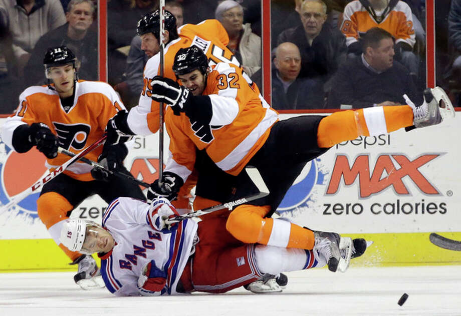 Philadelphia Flyers' Tom Sestito (32) collides with New York Rangers' Jeff Halpern (15) during the first period of an NHL hockey game, Thursday, Jan. 24, 2013, in Philadelphia. (AP Photo/Matt Slocum) / AP