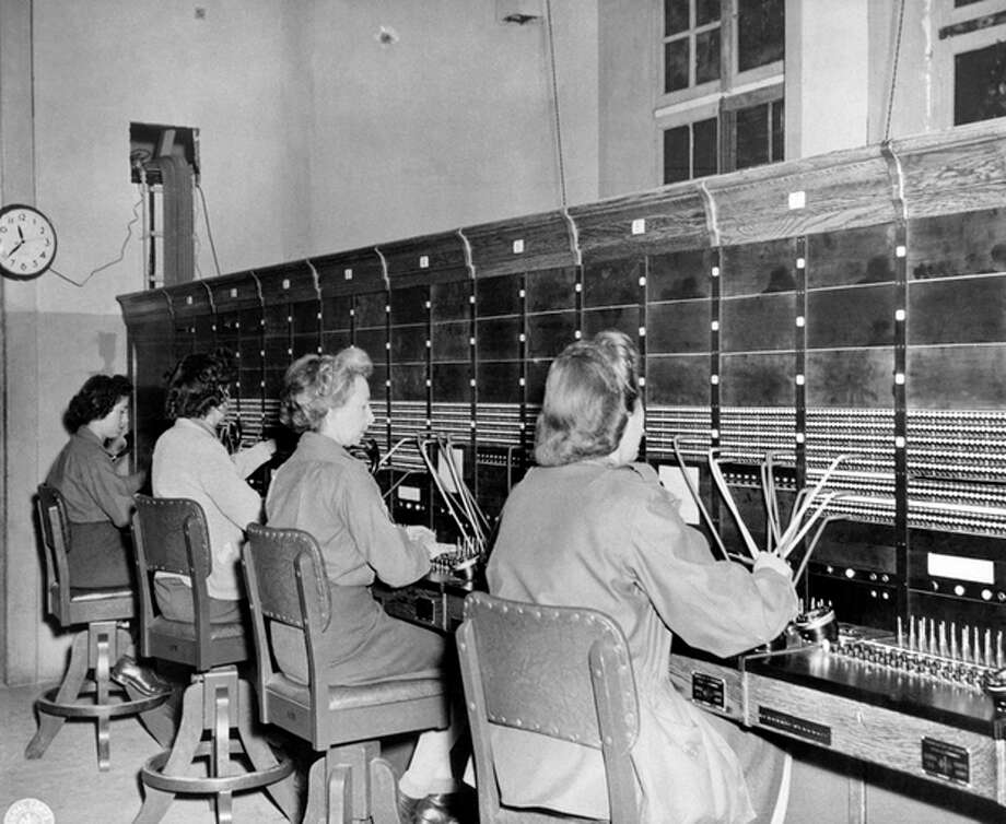 FILE - In this Oct. 7, 1944, file photo provided by the U.S. Army Signal Corps, Women Army Corps (WAC) switchboard operators put military calls through at their base in France. (AP Photo/U.S. Army Signal Corps) / U.S. Army Signal Corps
