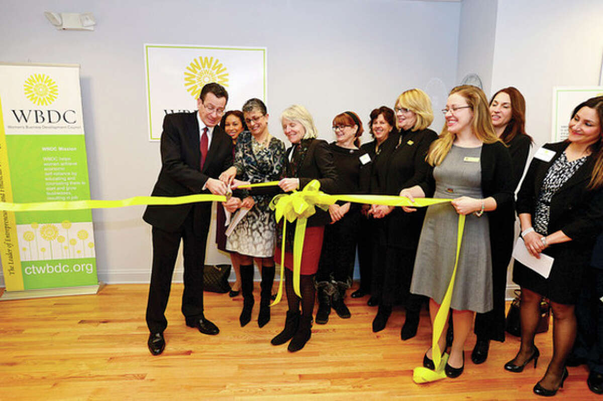 Hour photo / Erik Trautmann Governor Dannel P. Malloy helps cut the ribbon for the WBDC office expansion in Stamford this week.