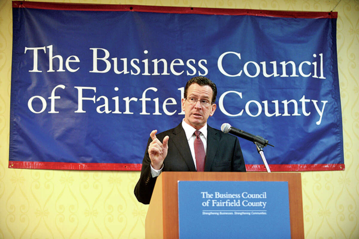 Featured speaker Governor Dannel P. Malloy addressses the crowd at the Business Council of Fairfield County's Winter Luncheon at the Stamford Sheraton Wednesday. Hour photo / Erik Trautmann