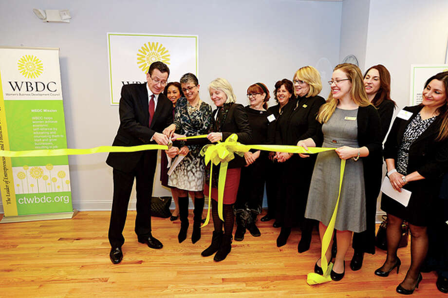 Governor Dannel P. Malloy hel;ps cut the ribbon for the WBDC office expansion in Stamford Wednesday. Hour photo / Erik Trautmann / (C)2012, The Hour Newspapers, all rights reserved