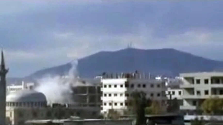 This image from amateur video made available by Shaam News Network on Monday, Feb. 6, 2012, purports to show an explosion in Damascus, Syria. Government forces shelled the central Syrian city of Homs on Monday, striking a makeshift medical clinic and residential areas and killing more than a dozen people in the third day of a new assault on the epicenter of the country's uprising, activists said. (AP Photo/Shaam News Network via APTN) THE ASSOCIATED PRESS CANNOT INDEPENDENTLY VERIFY THE CONTENT, DATE, LOCATION OR AUTHENTICITY OF THIS MATERIAL. TV OUT / Shaam News Network