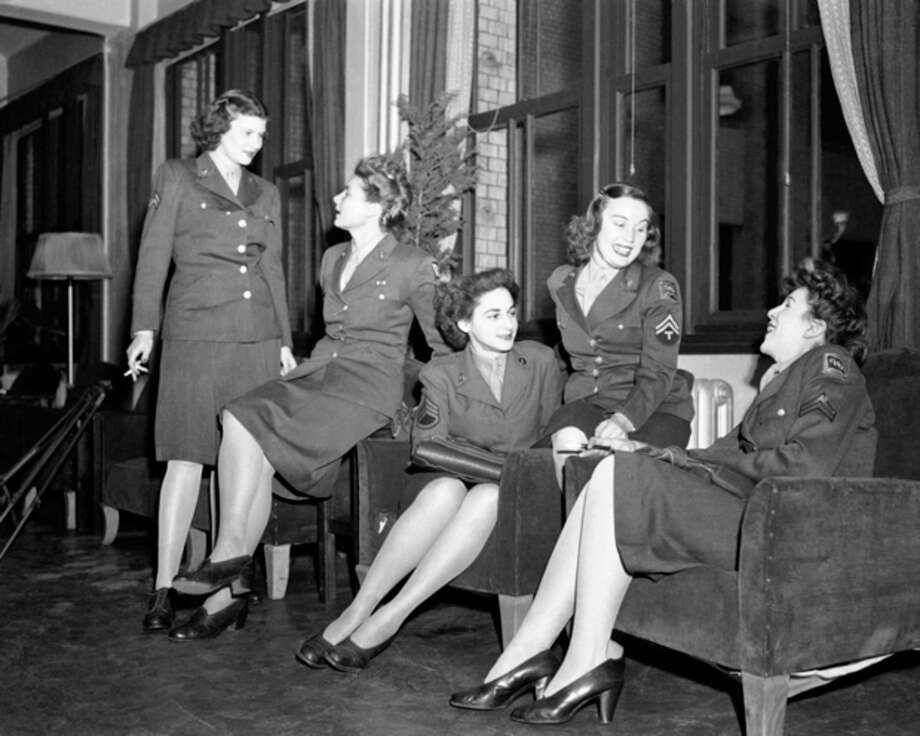 FILE - In this March 1947 file photo, a group of Women Army Corps (WAC) personnel pose in a Tokyo lounge. (AP Photo, File) / AP