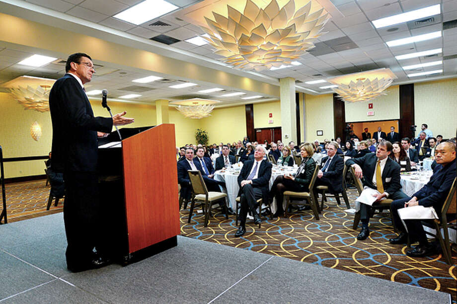 Featured speaker Governor Dannel P. Malloy addressses the crowd at the Business Council of Fairfield County's Winter Luncheon at the Stamford Sheraton Wednesday. Hour photo / Erik Trautmann / (C)2012, The Hour Newspapers, all rights reserved