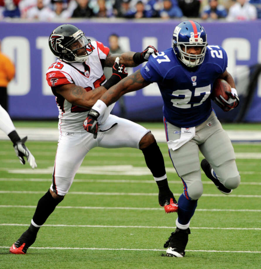 Atlanta Falcons strong safety William Moore (25) tries to stop New York Giants running back Brandon Jacobs (27) during the first half of an NFL wild card playoff football game Sunday, Jan. 8, 2012, in East Rutherford, N.J. (AP Photo/Bill Kostroun) / FR51951 AP