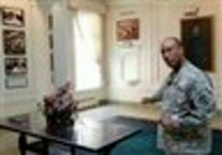 U.S. Army Col. Norvell V. Coots gestures during an interview in the main lobby of the Walter Reed Army Medical Center in Washington, Thursday, July 21, 2001. Walter Reed Army Medical Center, the military's flagship hospital where privates to presidents have gone for care for more than a century, is closing its doors. Hundreds of thousands of the nation's war wounded from World War I to today have received treatment at Walter Reed, including 18,000 troops who served in Iraq and Afghanistan. (AP Photo/Luis M. Alvarez) / FR596 AP