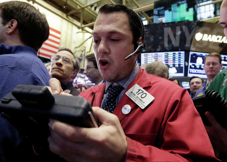 Trader Michael Zicchinolfi, center, works on the floor of the New York Stock Exchange, Friday, Jan. 25, 2013. Stocks are opening higher on Wall Street ahead of what is expected to be more upbeat data on housing from the government. (AP Photo/Richard Drew) / AP