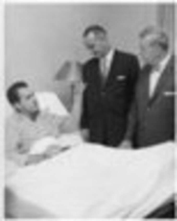 FILE - In this August 1960 file photo provided by Walter Reed Army Medical Center, Presidential candidate Richard M. Nixon is visited at Walter Reed Army Medical Center by Vice Presidential candidate Sen. Lyndon Johnson, Senator John Kennedy's running mate, and Senator Everett Dirksen. Nixon spent two weeks at Walter Reed recovering from a bacterial staph infection. (AP Photo/Walter Reed Army Medical Center, ho)