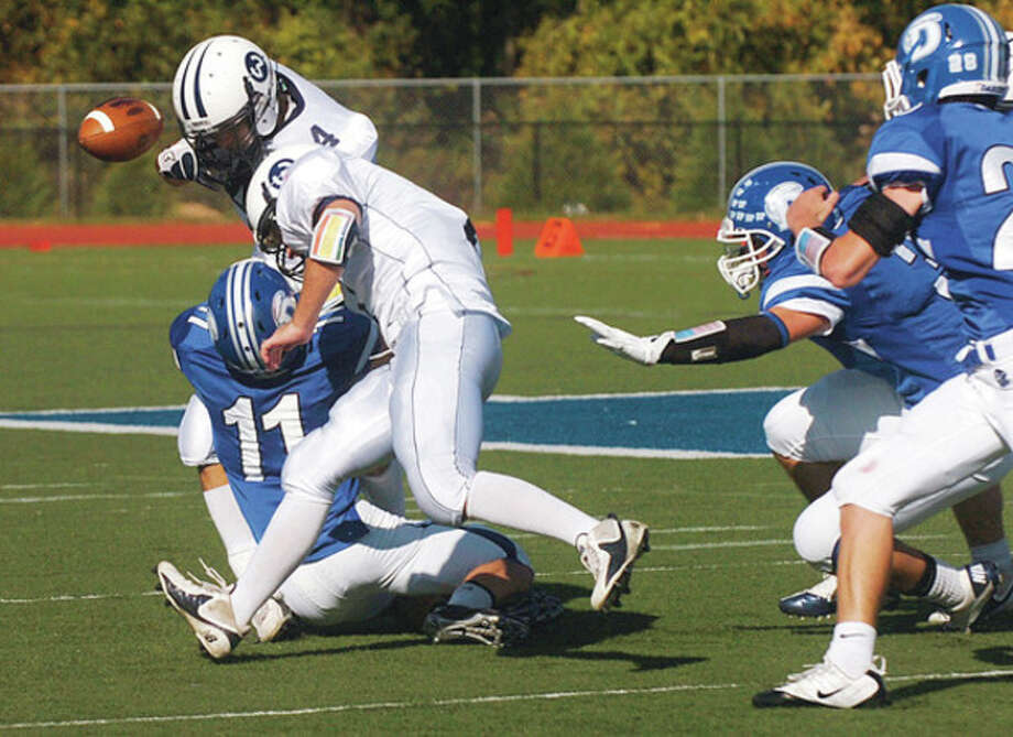 #4 for Wilton coughs up the ball during their game agaist Darien Saturday. Hour photo / Erik Trautmann / (C)2011, The Hour Newspapers, all rights reserved
