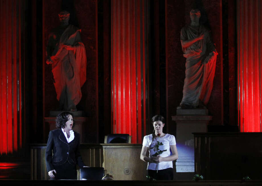 TO GO WITH HOLOCAUST OPERA STORY BY GEORGE JAHN - Katerina Beranova and Silke Doerner, from left, perform during the holocaust opera 'Spiegelgrund ' by Austrian composer Peter Androsch in the imperial council hall of the Austrian parliament in Vienna, Friday, Jan. 25, 2013. Androsch goes where few others have dared, with an opera depicting how Nazis methodically killed mentally or physically deficient children. The performance premieres to mark International Holocaust Day in the parliament of Austria, a nation still atoning for its role in atrocities committed by the Nazis. (AP Photo/Ronald Zak)