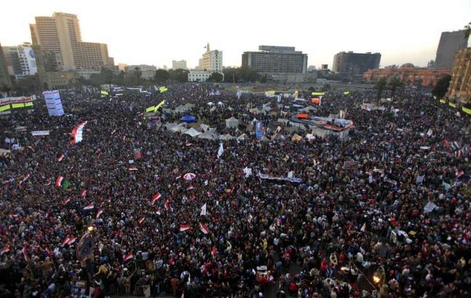 Thousands of Egyptian protesters gather in Tahrir Square, Cairo, Egypt, Friday, Jan. 25, 2013. Two years after Egypt's revolution began, the country's schism was on display Friday as the mainly liberal and secular opposition held rallies saying the goals of the pro-democracy uprising have not been met and denouncing Islamist President Mohammed Morsi. With the anniversary, Egypt is definitively in the new phase of its upheaval. (AP Photo/Khalil Hamra)