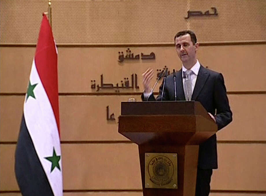 In this image made from video, Syrian President Bashar Assad delivers a speech in Damascus, Syria, Tuesday, Jan. 10, 2012. Assad gave his first speech Tuesday since he agreed last month to an Arab League plan to halt the government's crackdown on dissent. (AP Photo/Syrian State Television via APTN) SYRIA OUT / Syrian State TV via APTN