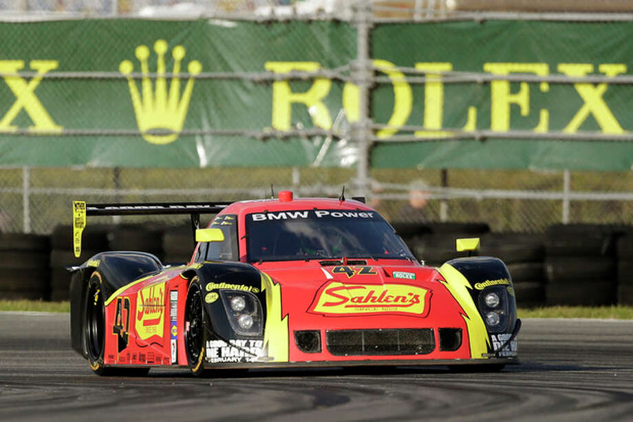 Dane Cameron drives the Team Sahlen BMW Riley to capture the No. 3 position during qualifying for the Rolex 24 hour auto race at Daytona International Speedway, Thursday, Jan. 24, 2013, in Daytona Beach, Fla. (AP Photo/John Raoux) / AP