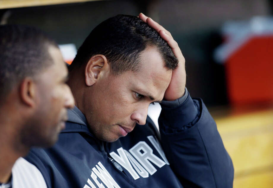 FILE - In this Oct. 18, 2012, file photo, New York Yankees' Alex Rodriguez watches from the dugout during Game 4 of the American League championship series against the Detroit Tigers in Detroit. Yankees general manager Brian Cashman says it's possible that third baseman Alex Rodriguez could miss the entire season while coming off hip surgery. He made his remarks Friday on WFAN radio in New York. (AP Photo/Paul Sancya, File) / AP