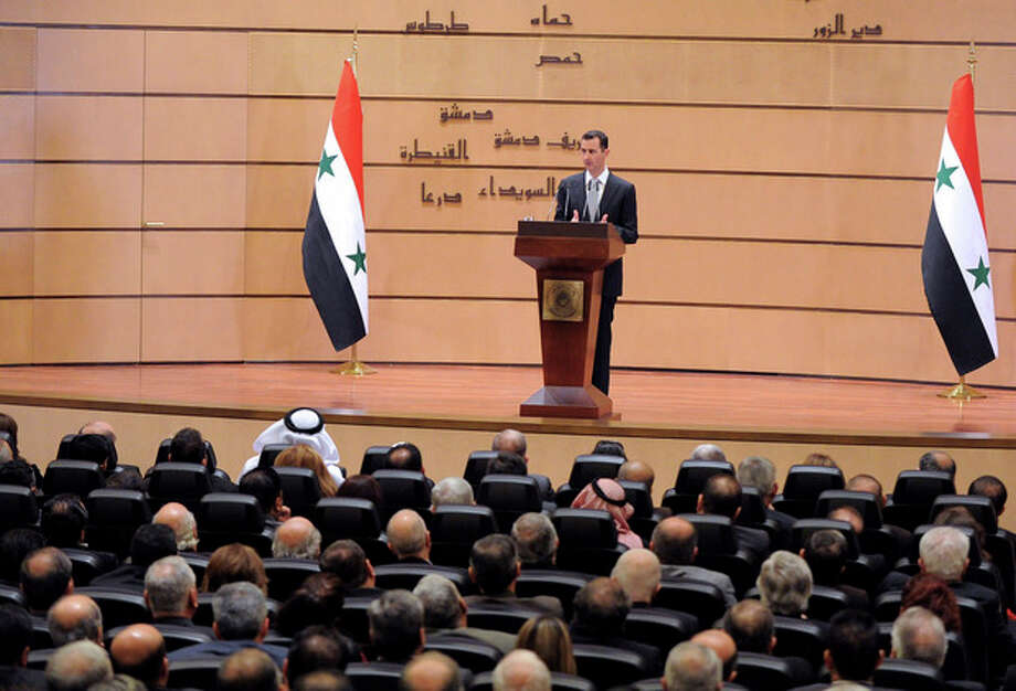 In this photo released by the Syrian official news agency SANA, Syrian President Bashar Assad delivers a speech at Damascus University, Syria, Tuesday, Jan. 10, 2012. Assad said Tuesday he will not step down, insisting that he still has his people's support despite a 10-month-old uprising against him. In his fourth speech since the Syrian revolt began in March, Assad also lashed out at the Arab League and accused the Cairo-based bloc of failing to protect Arab interests. The president has made few public appearances since the anti-government uprising began in March, inspired by the revolutions sweeping the Arab world. The regime's crackdown on dissent has killed thousands and led to international isolation and sanctions(AP Photo/SANA) EDITORIAL USE ONLY / SANA